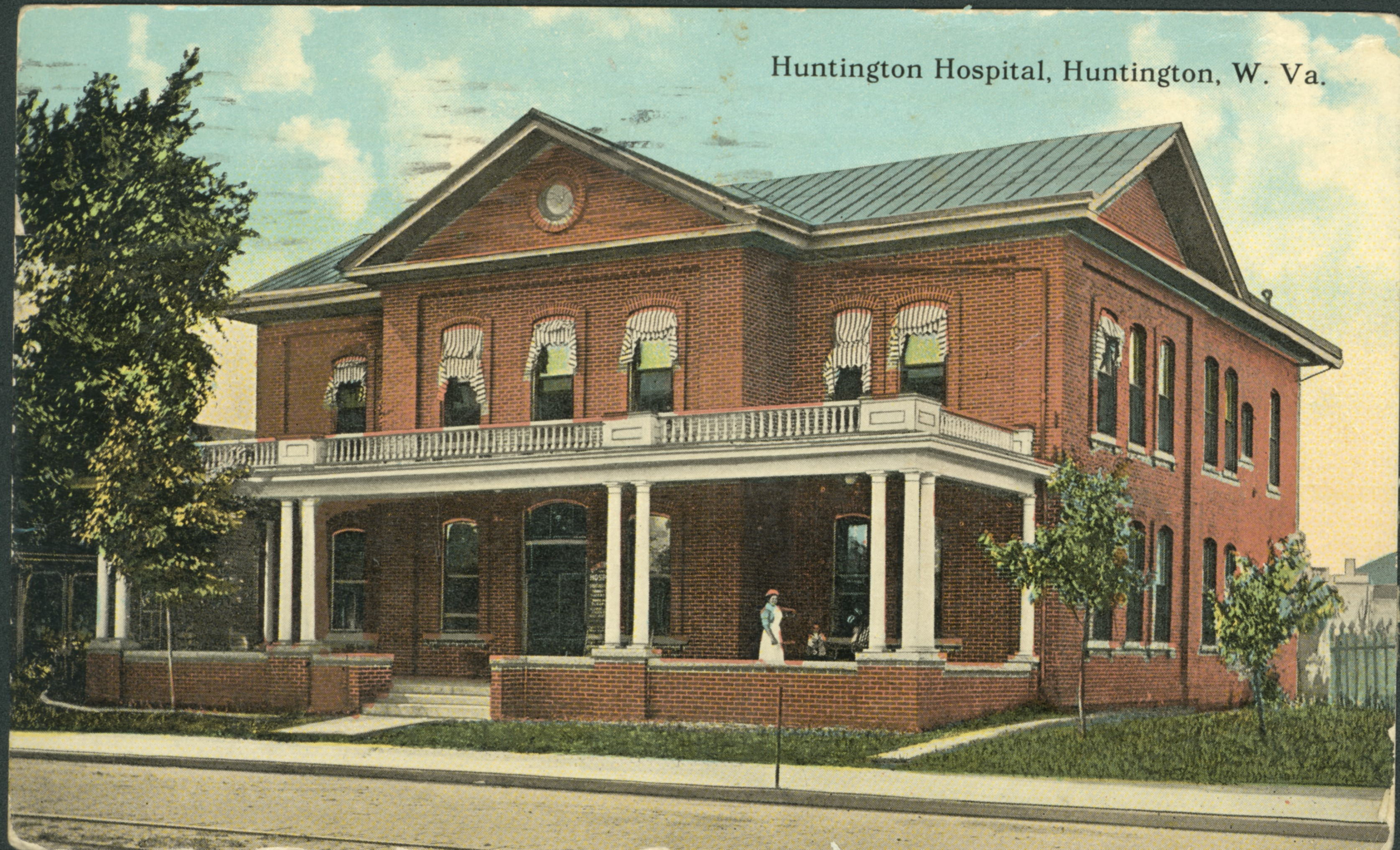 Postcard of Huntington Hospital, notable showing the addition of a porch. Image courtesy of Marshall University Special Collections.
