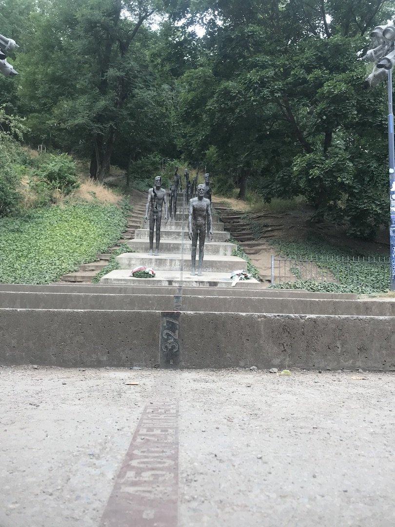 The embedded bronze strip: 4500 died in prison.