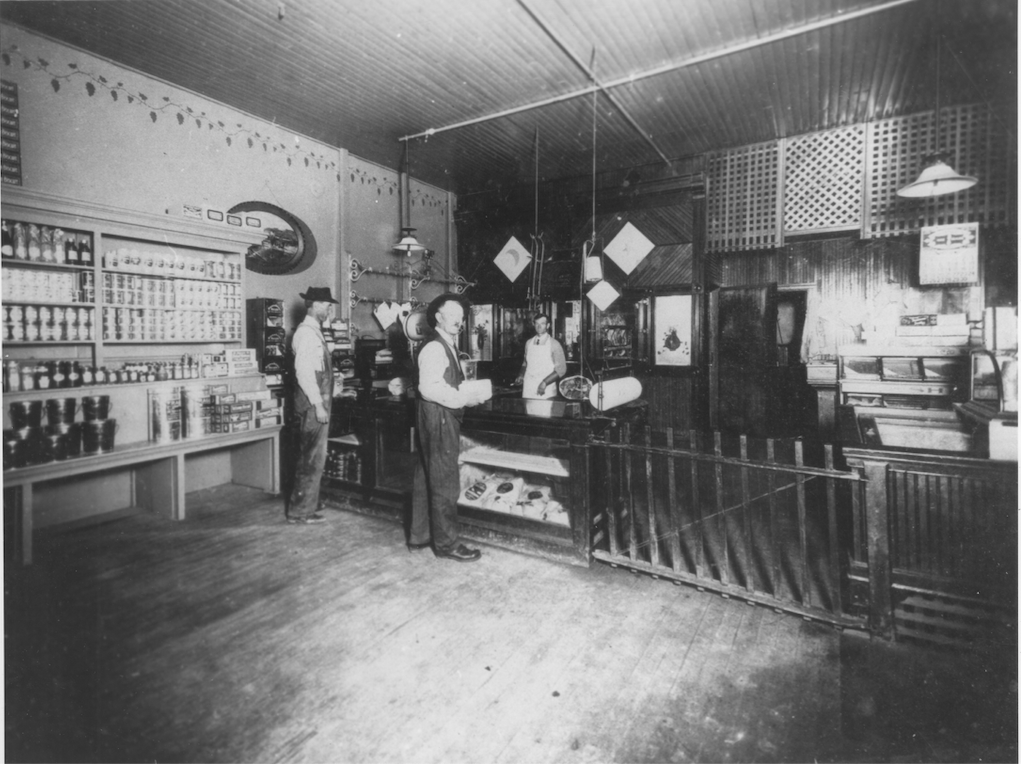 A historic photo of the interior of the N. Frank & Bros Meat Market. 