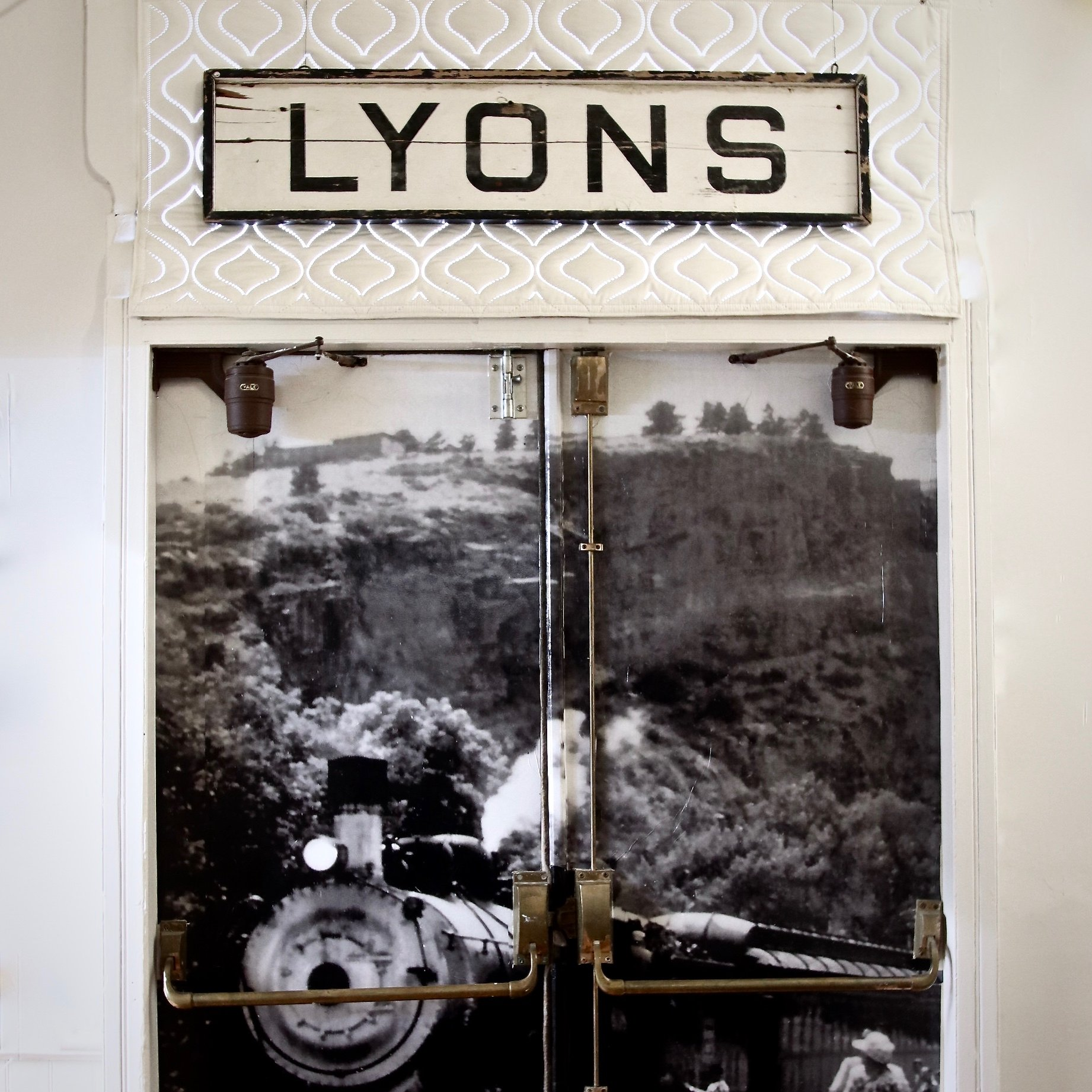 This sign was in the original Train Depot building. It is now on display at the Lyons Redstone Museum. 