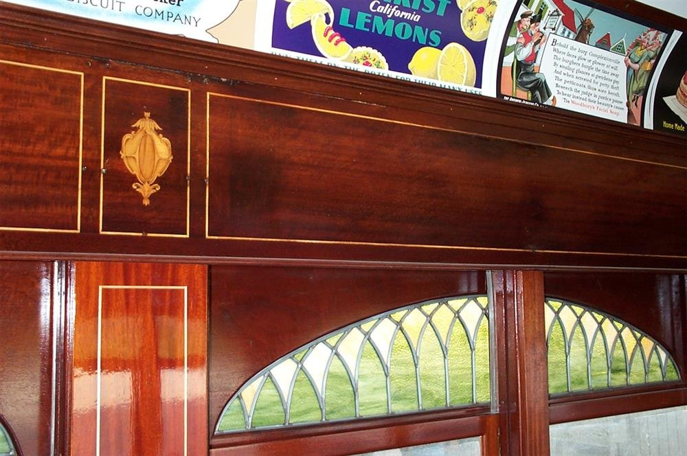 The car features mahogany paneling and stained glass windows.