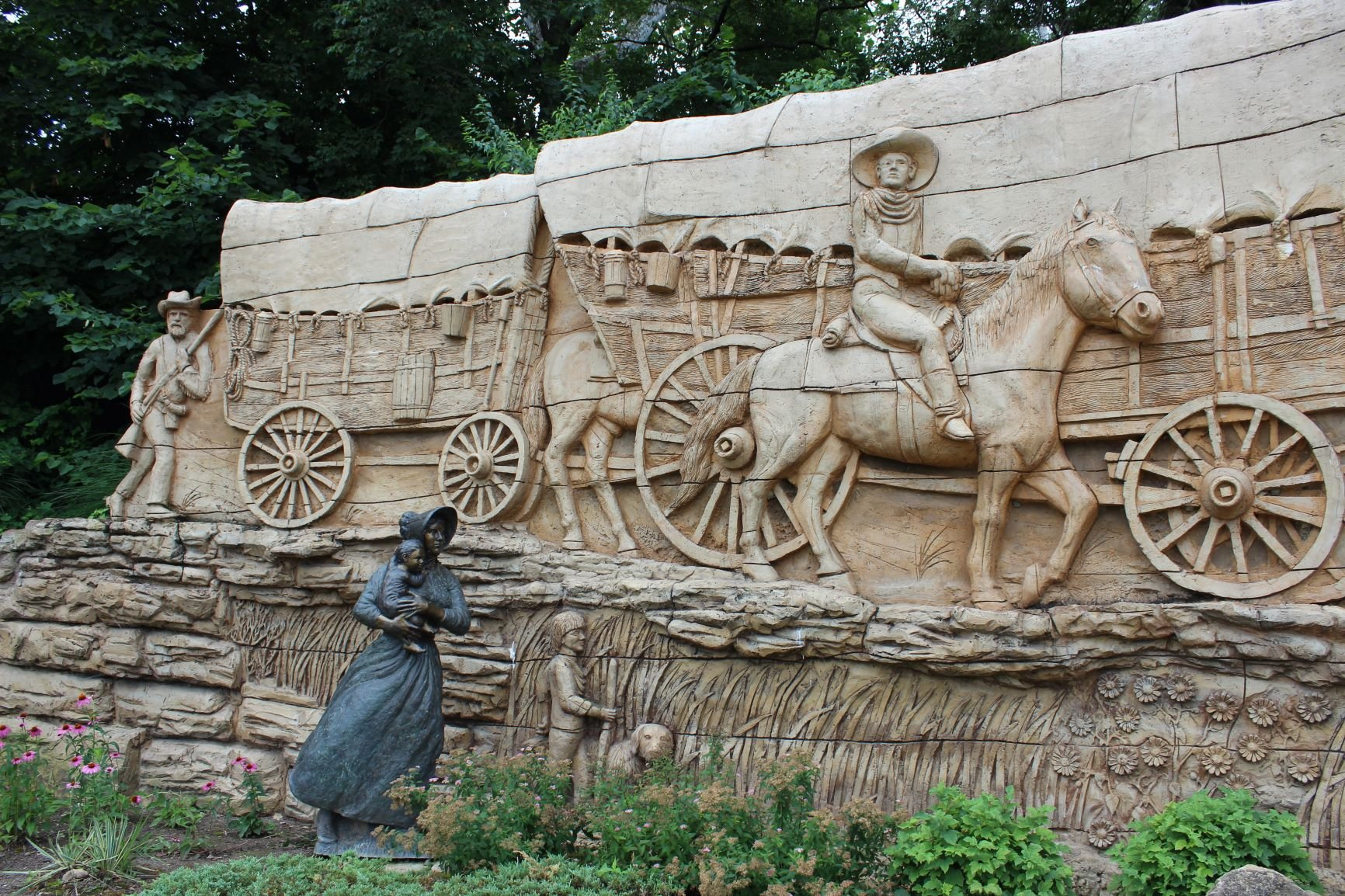 Detail of pioneer family in wagon train sculpture by Charles Goslin. Photo by Cynthia Prescott.