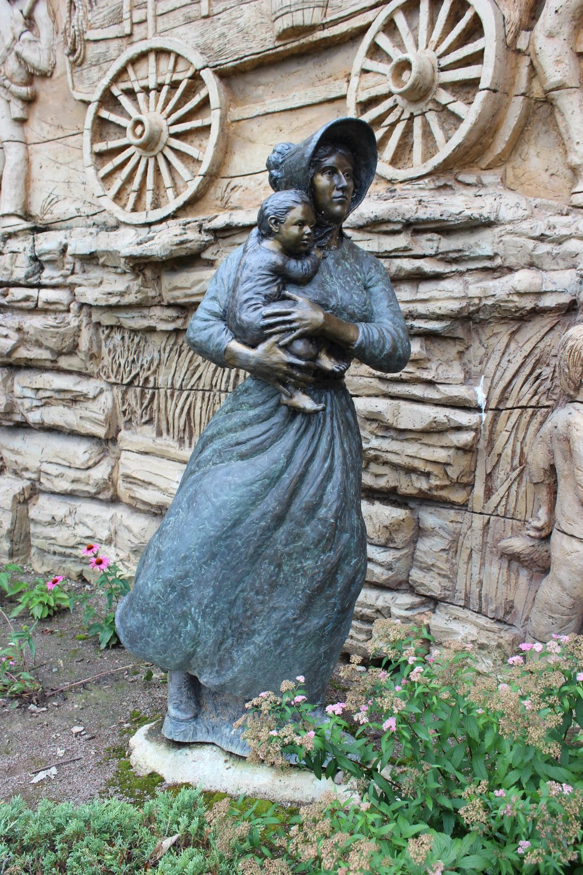Compare this 2006 Charles Goslin pioneer woman in Shawnee, KS, to the one he sculpted for Independence, MO. Photo by Cynthia Prescott.