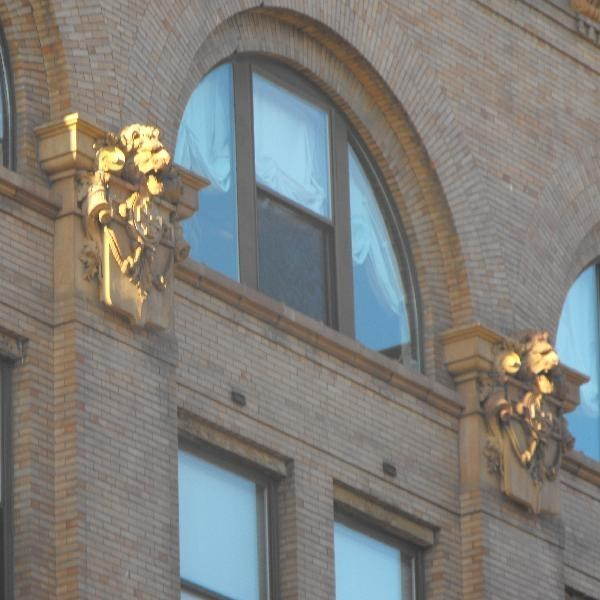 A closeup of the terra cotta lions on the fifth floor. Photo credit: waymarking.com
