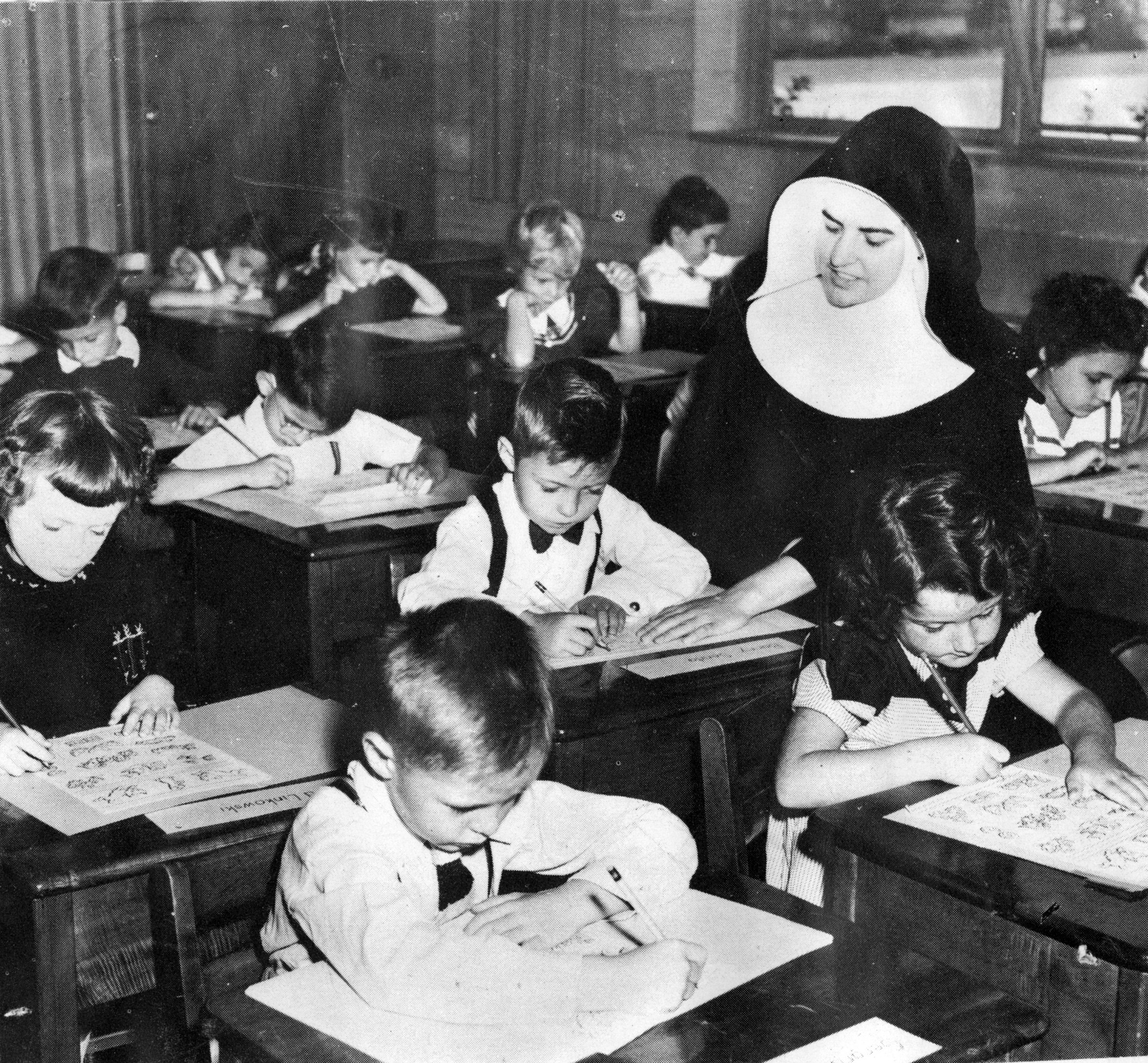 Sister Joyce Braun with pupils at St. Mary's School, c. 1950.