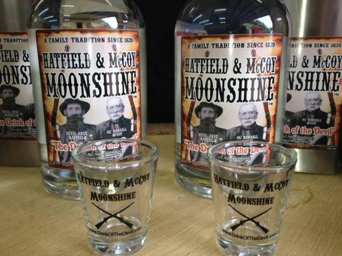 A few bottles of the company's moonshine as well as their custom shot glasses.