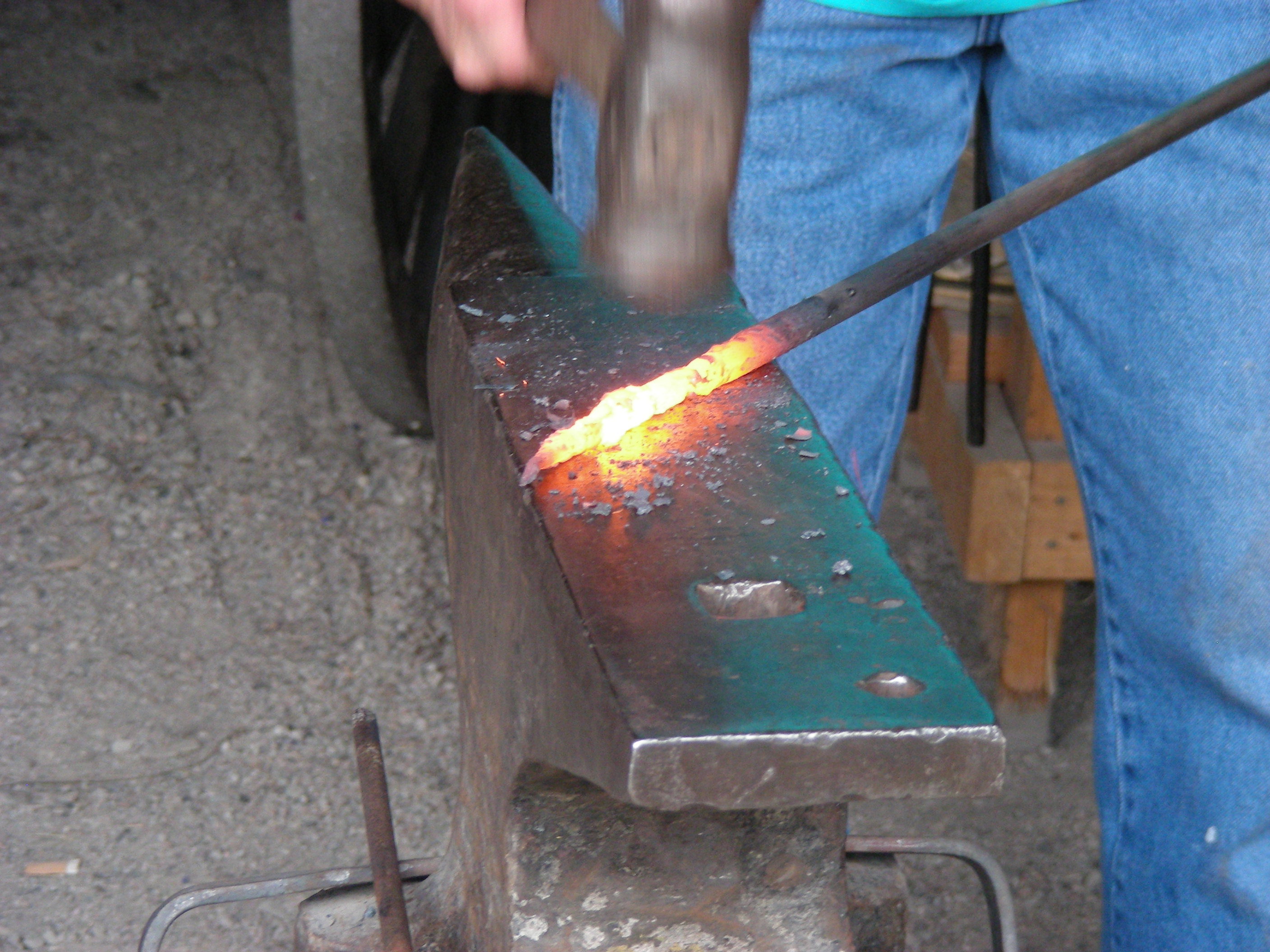 One of Four Mile's blacksmiths hammers a piece of hot steel