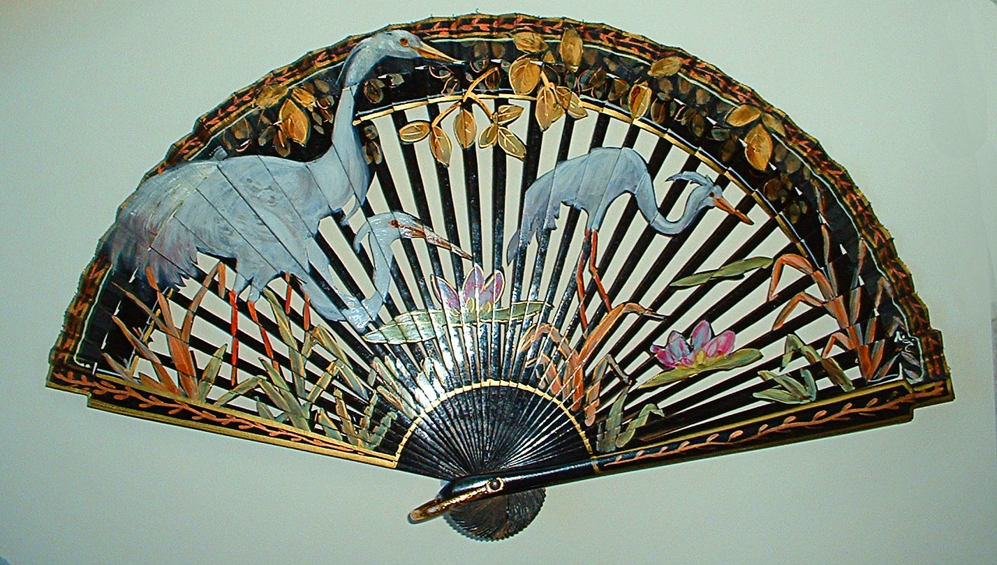 Hand painted blue herons on a fan in the museum's collection.