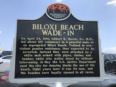 The marker was dedicated in 2009 and is in the parking lot by the beach.