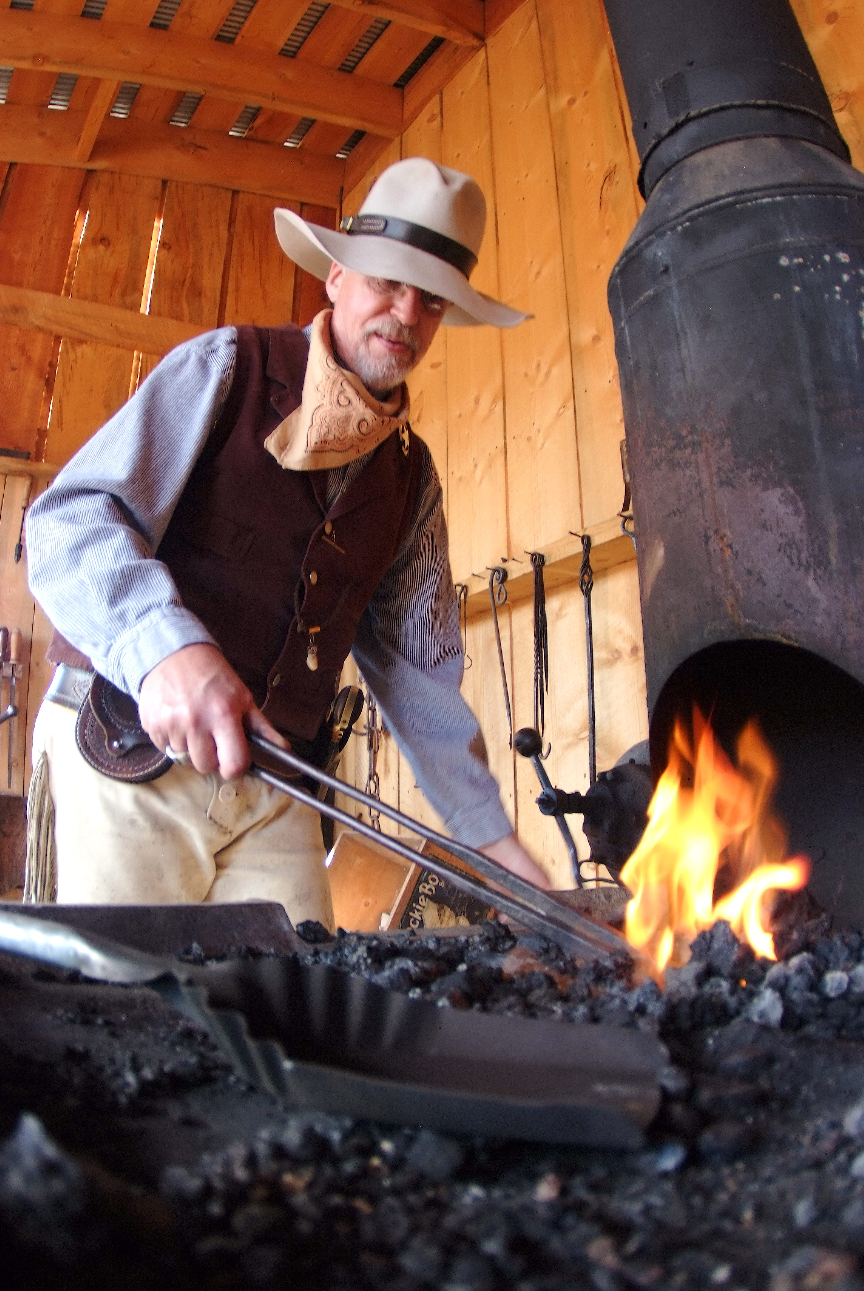 Another Four Mile docent and blacksmith works the forge