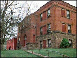 This building was a main component of Sand Fork High and Elementary School. Both the high and elementary school featured other buildings not featured in this picture.