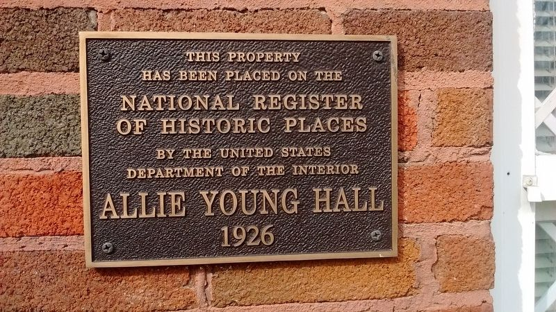 Allie Young Hall, which has since taken the place of the Normal School, with its plaque commemorating its recognition from The National Register of Historic Places.