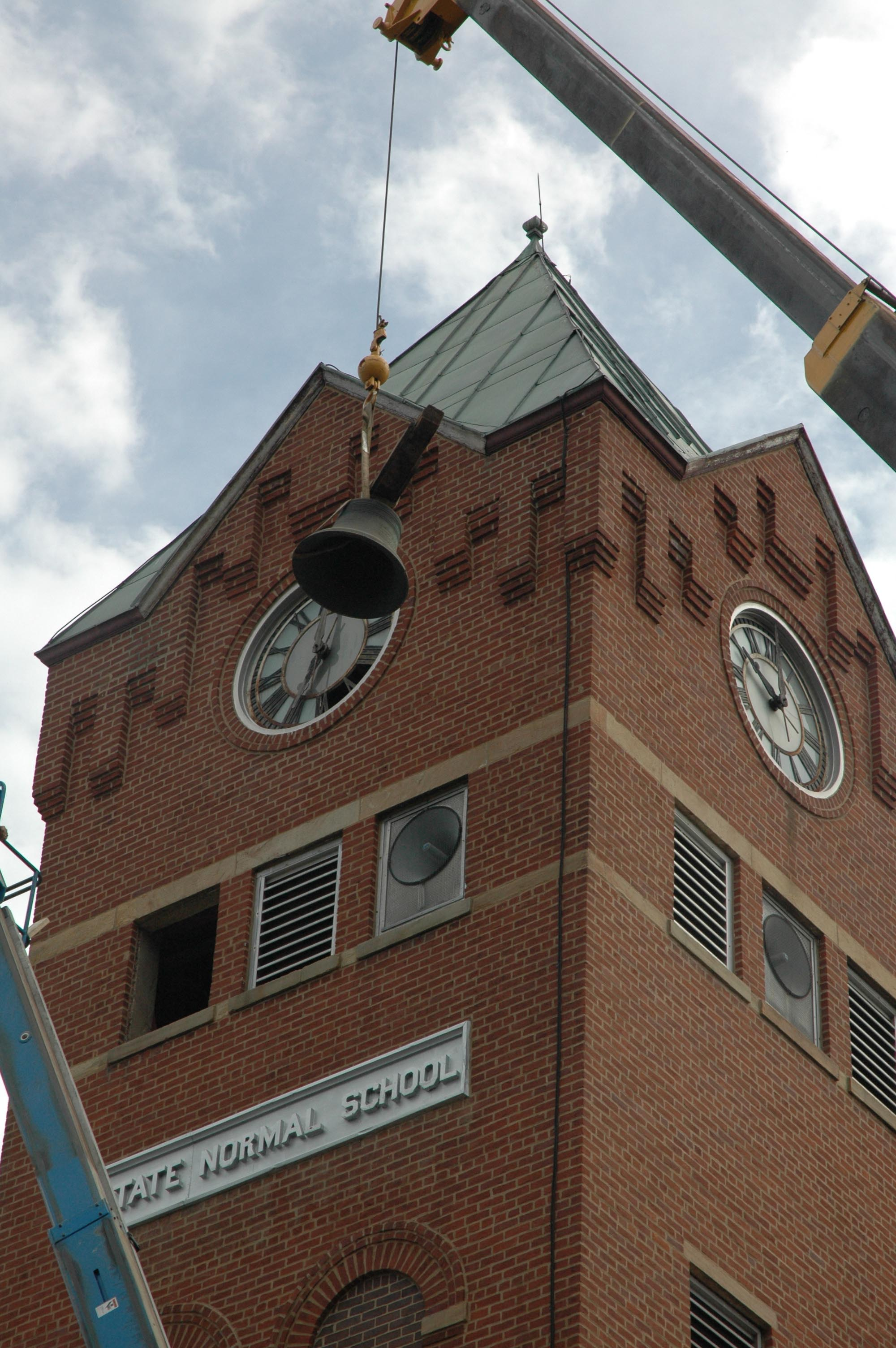 Heavy equipment operators assisted in the removal of the heaviest items from the Clock Tower.