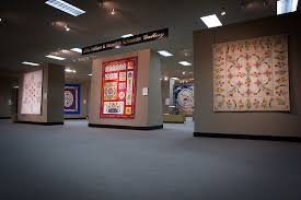 Quilts on display inside the museum.