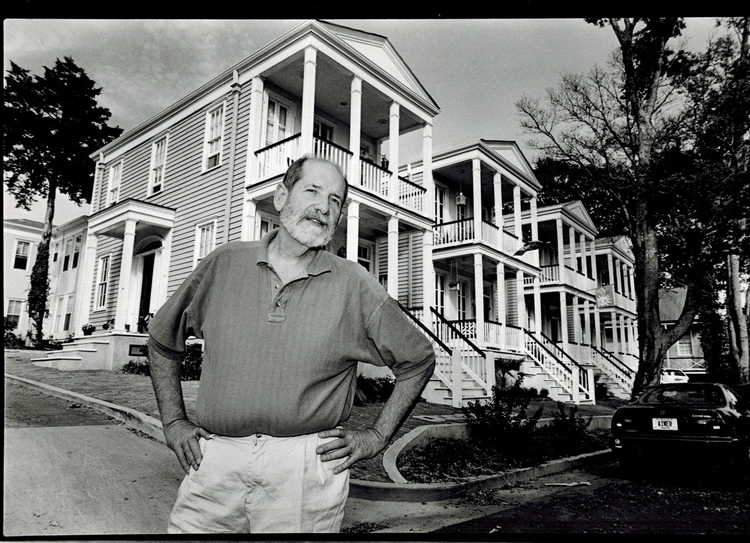 Owner Dan Camp standing in front of some of the houses in the Cotton District