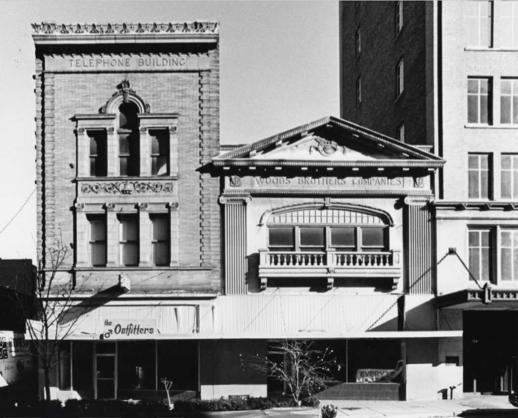1980 photo of Woods Brothers Building (R) and Nebraska Telephone Co. Building (L) by Richard L. Johnson