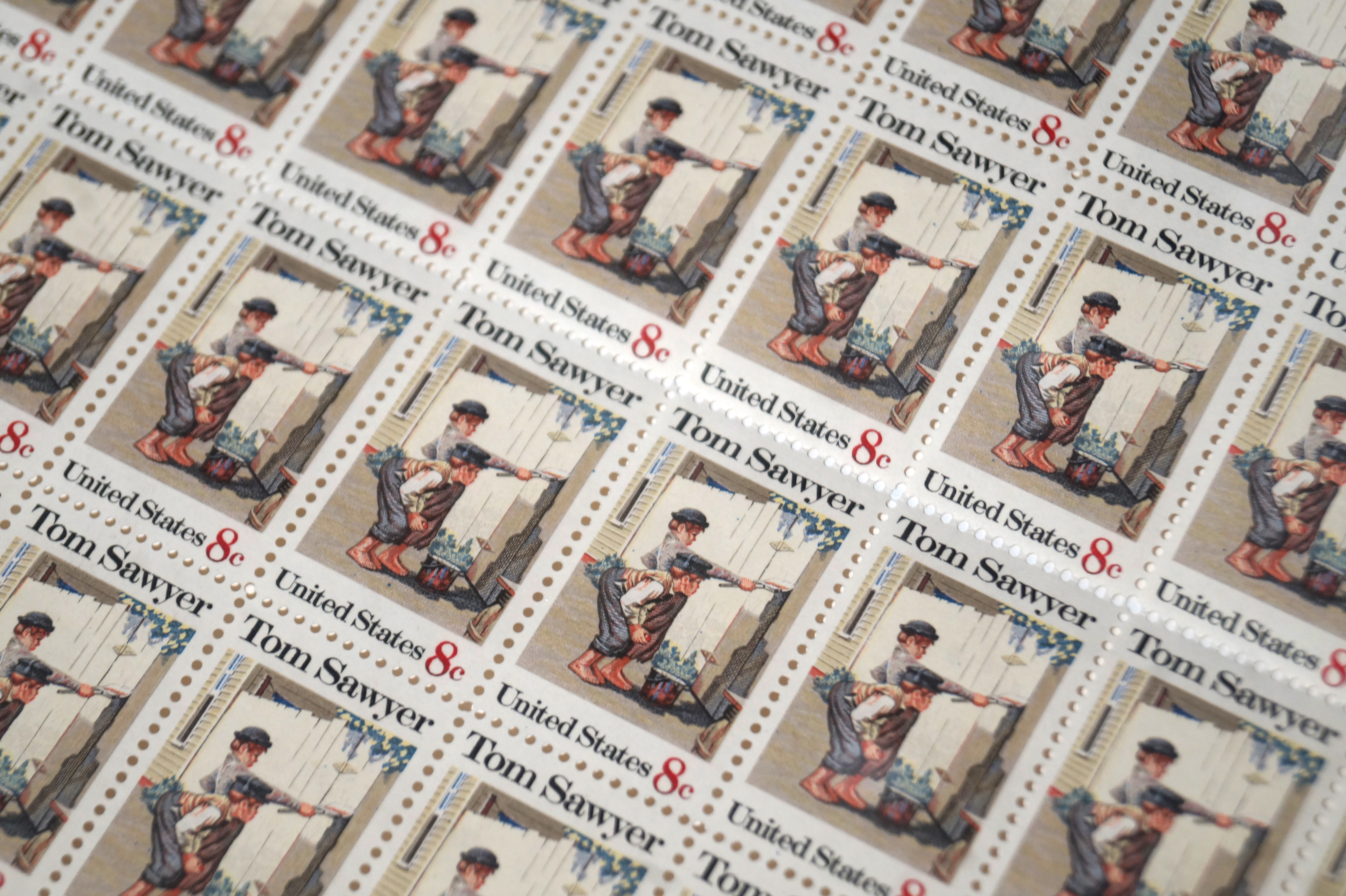 On October 13, 1972, the U.S. Postal Service released an 8-cent Tom Sawyer commemorative stamp to celebrate the popular novel written by Mark Twain.  This sheet of stamps was signed in the top left corner by sitting president, Richard M. Nixon.