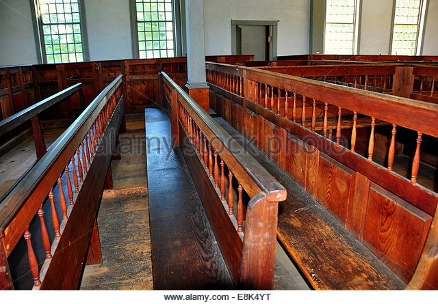 A close up of the pews within the meeting house.
