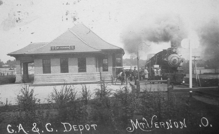 A postcard featuring the depot