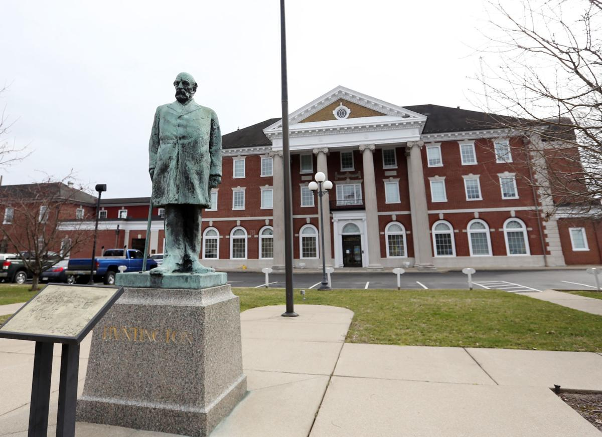 The former depot and the statue of Huntington today