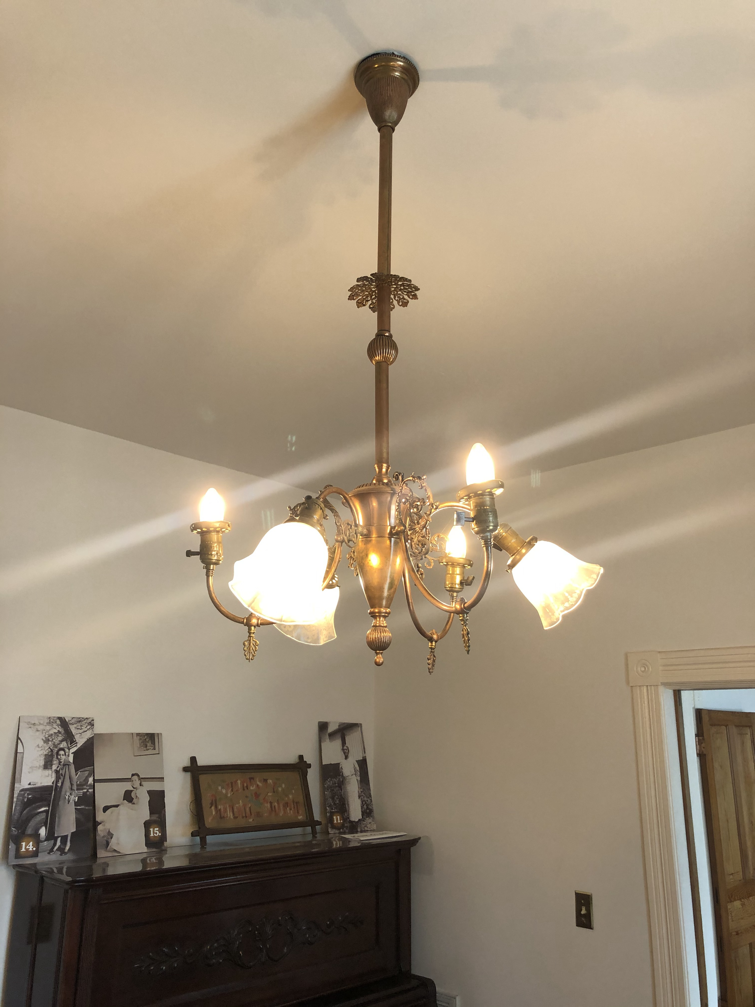 A gas and electric chandelier, purchased by Dr. Pope from Europe.