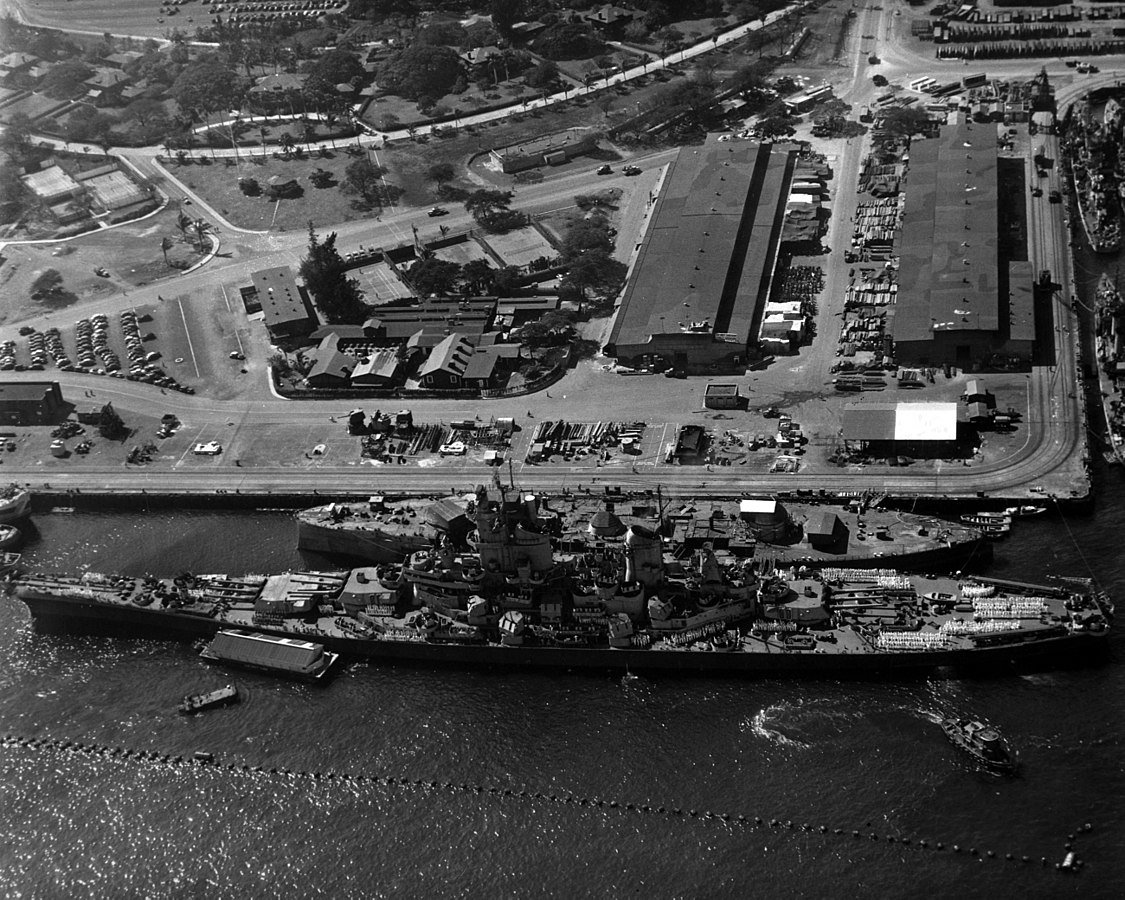 Wisconsin docked in Pearl Harbor on en-route to join the Pacific Fleet in 1944. She is pictured alongside the hulk of the USS Oklahoma, which was destroyed in the Japanese attack in 1941.