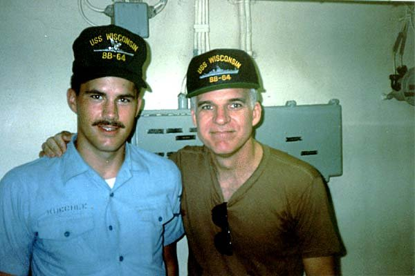 Crewman Steve Kuechle on board the USS Wisconsin with actor-comedian Steve Martin. Photo courtesy of USSWisconsin.org.