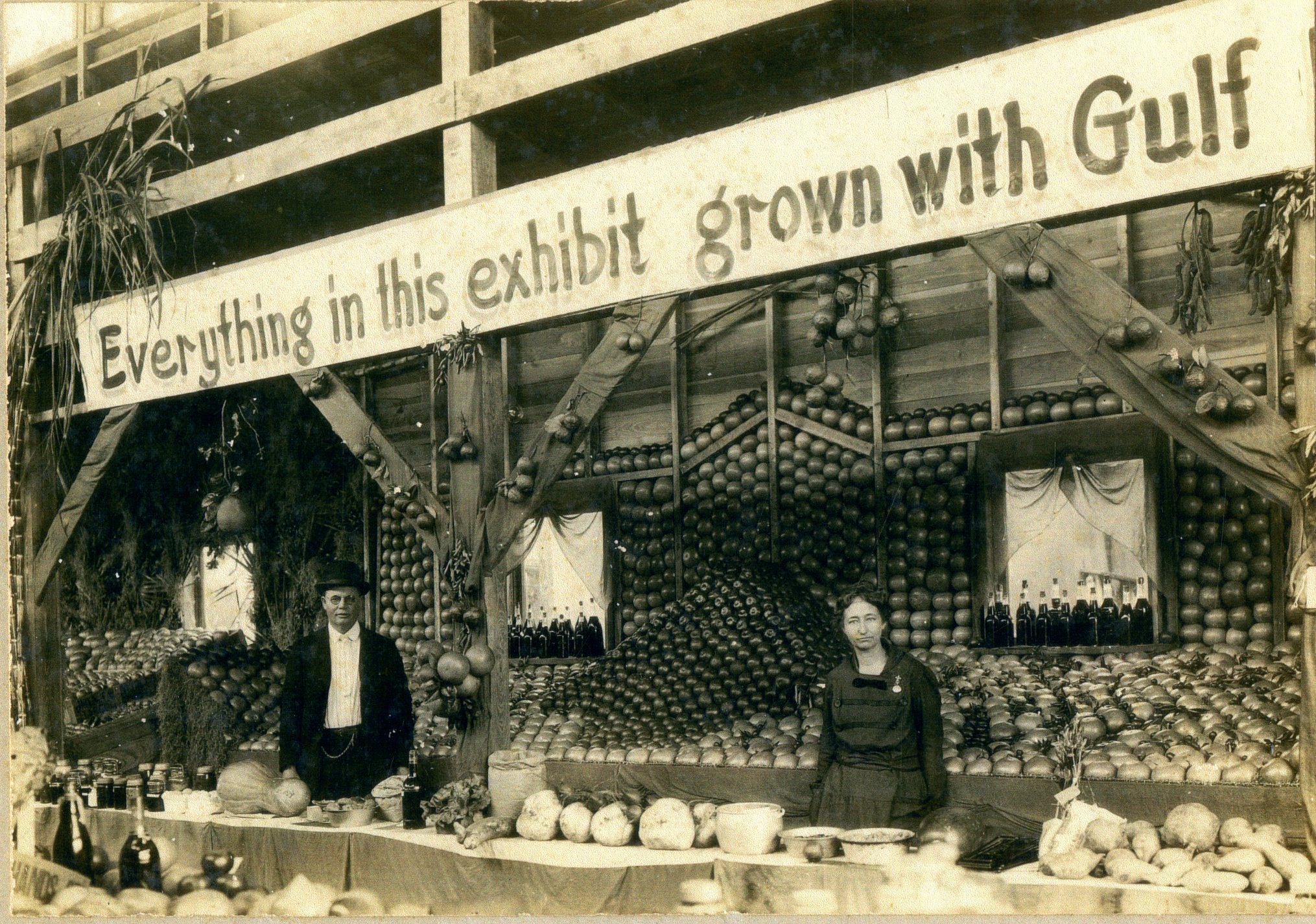 Ancil and Doris Walsingham at their exhibit at the Pinellas County Fair, Largo, Florida, circa 1900.