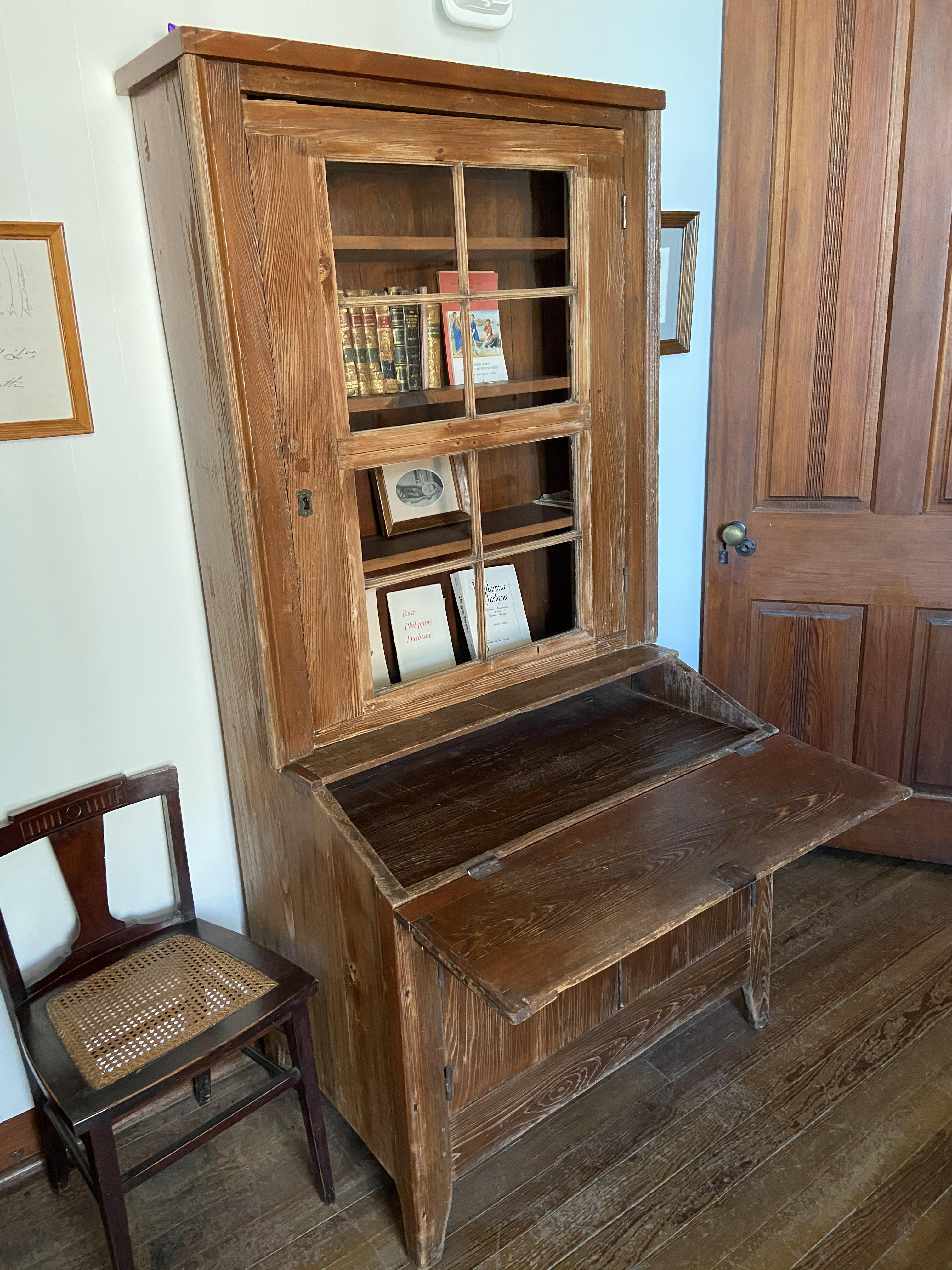This desk was constructed for use by St. Philippine Duchesne who traveled from Missouri in 1822 to check on the progress of the mission and to see for herself the conditions under which the Sisters were laboring.  It was used by various superiors in the years following her visit.
