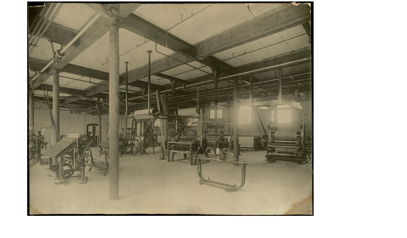 Cloth finishing equipment at Lowell Textile School, ca. 1900-1920.