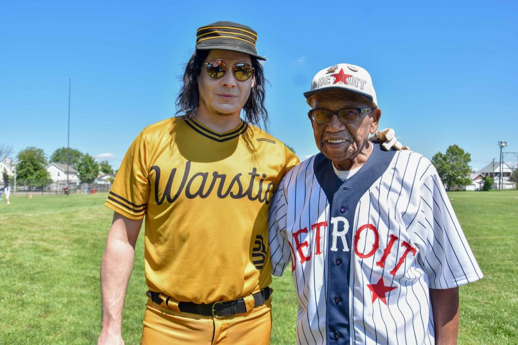 Detroit native and Raconteurs frontman Jack White (left) and 92-year-old former Negro League ballplayer Ron Teasley talk a little baseball before Teasley's ceremonial first pitch Thursday at historic Hamtramck Stadium.