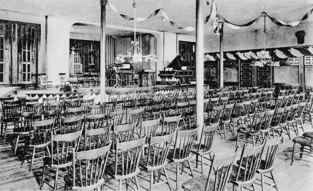 Irving College Auditorium located on the lower floor of Columbian Hall in 1910. The auditorium was set up for nondenominational chapel services.