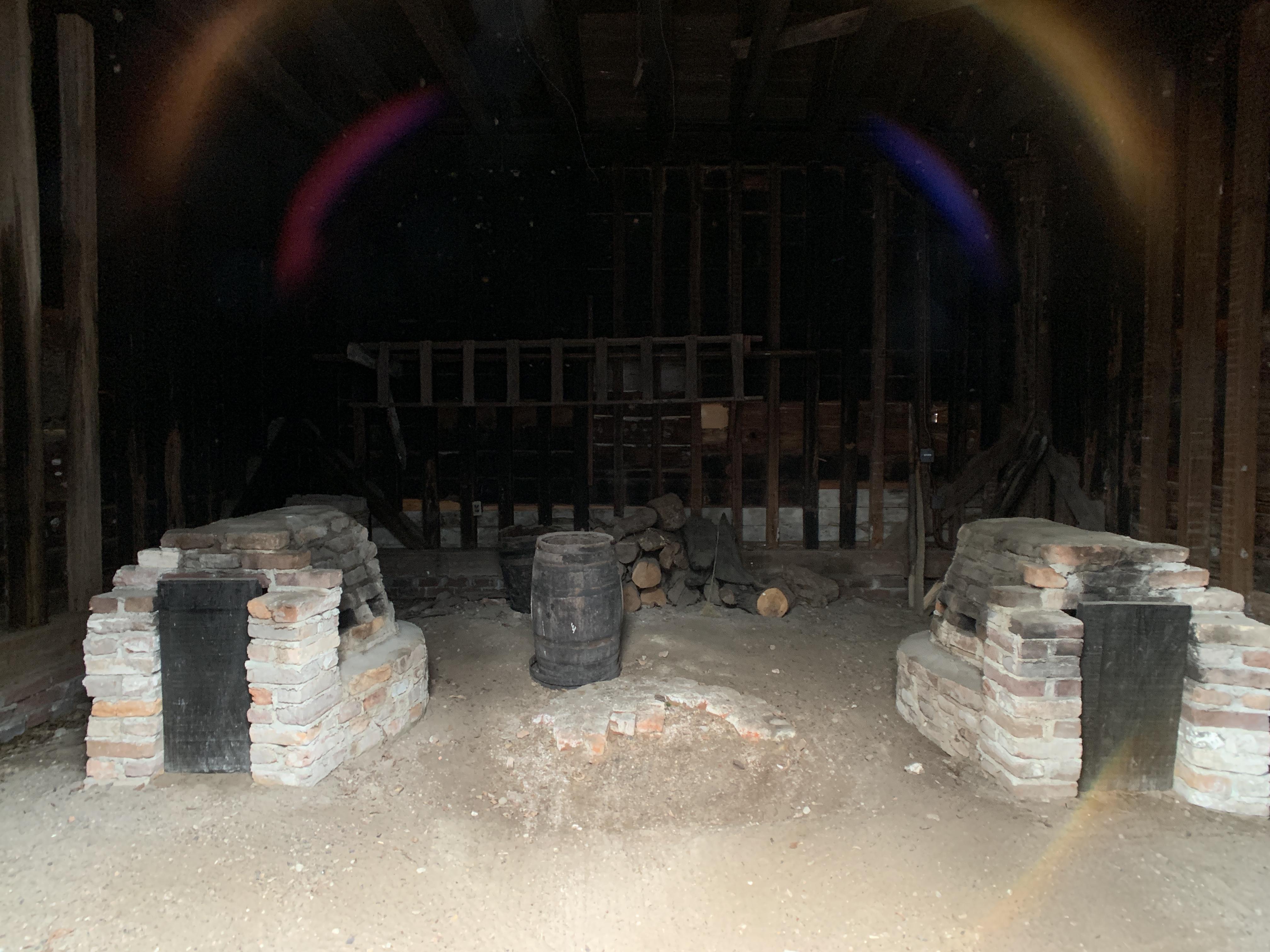Interior of Smokehouse showing horseshoe hearths