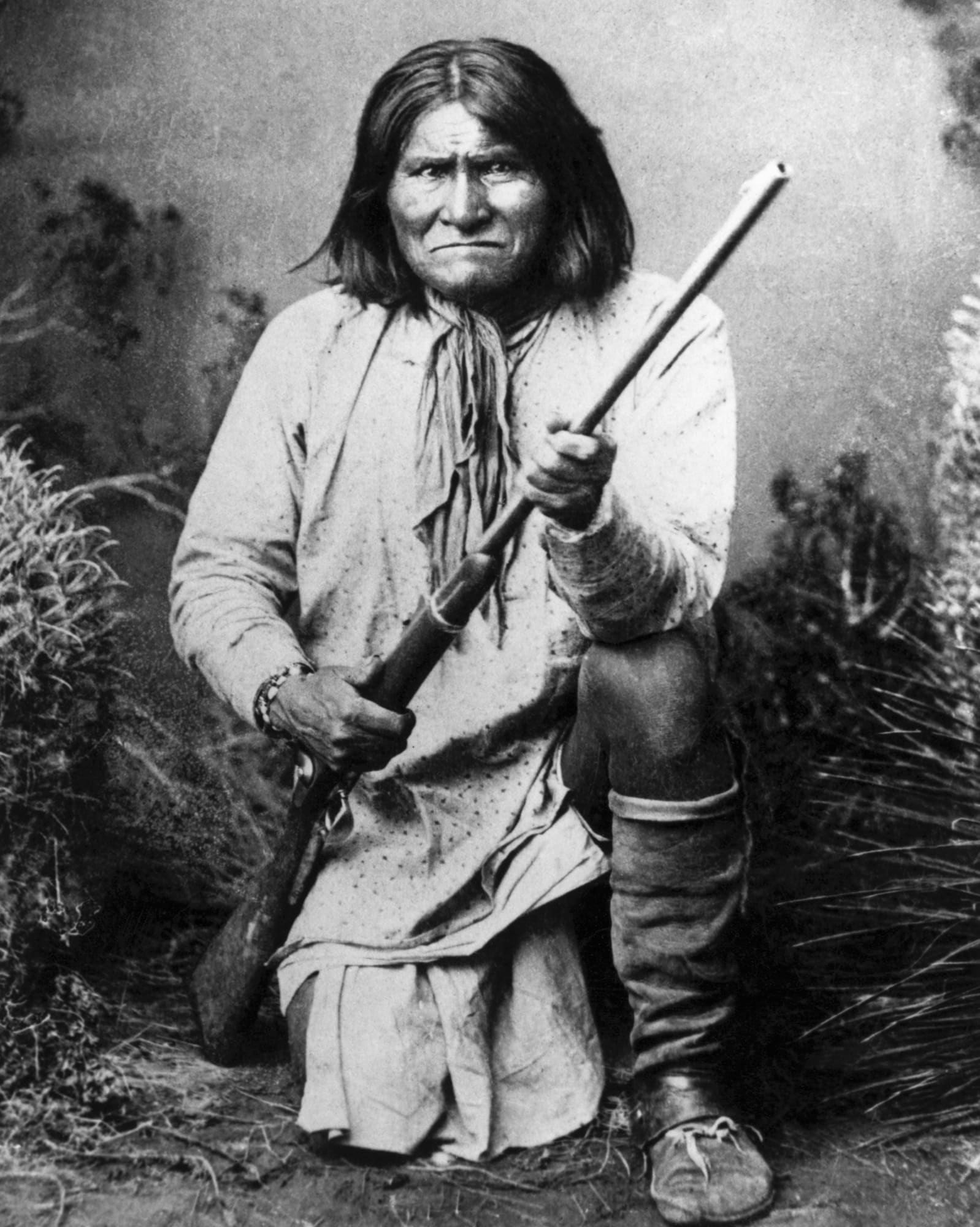 Geronimo, an Apache leader who was fearless in battle, posing with a rifle.