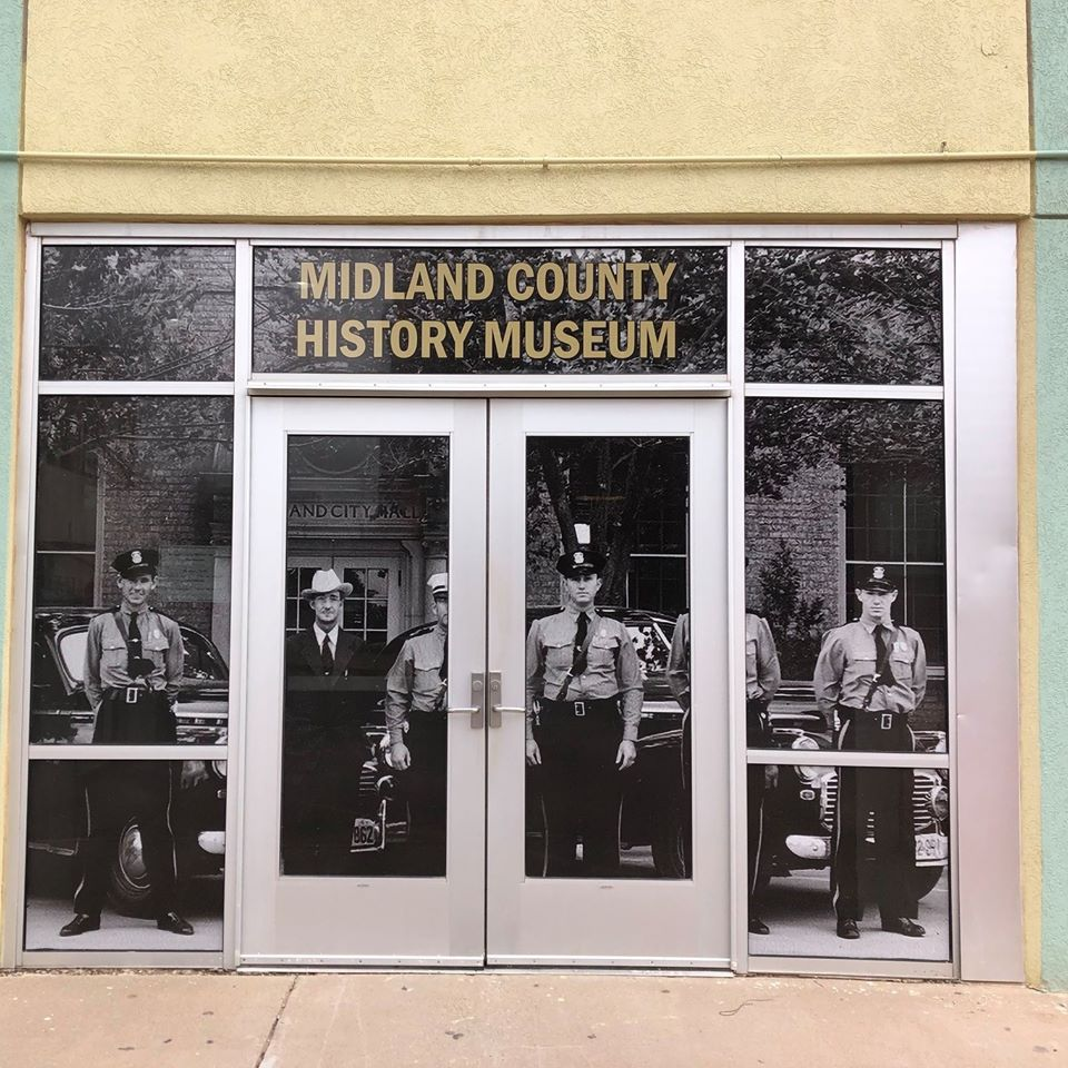 The Museum entrance doors now have historic photograph cover.