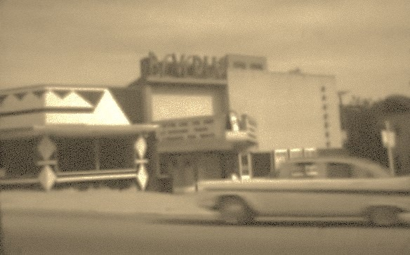 The Beverly, circa 1950s, with Evans Supermarket on its left