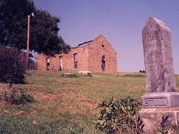 This pictures shows the headstone for the grave of the towns founder Silvester Stull. In the background you can see the ruins of the old church before it was torn down in 2002. This photo, along with many others, portrays the graveyard as an erie place where hauntings are in no short supply.