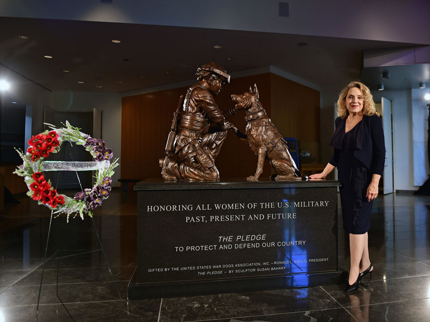 """Front side of """"The Pledge"""" monument with sculptor, Susan Bahary"""