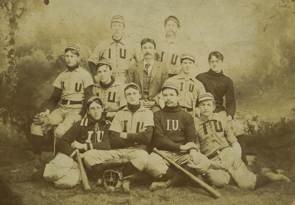 The 1895 Indiana Baseball Team pictured in jerseys with I and U across the chest similar to the sweaters of the university.