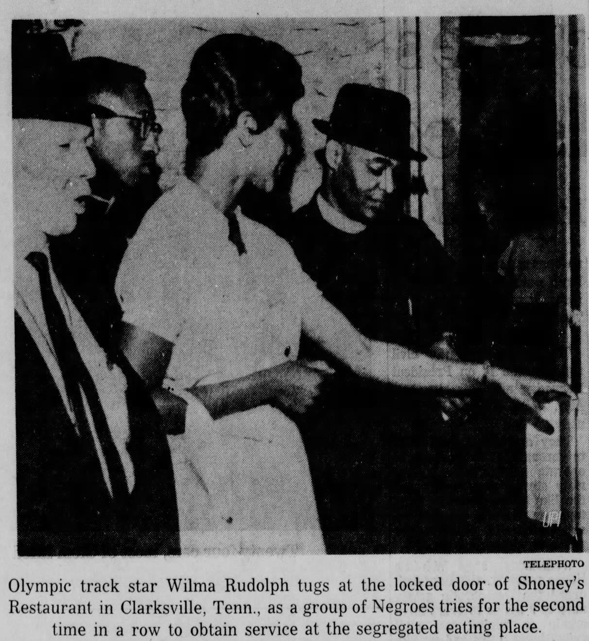 Wilma Rudolph and members of the Citizens Committee try to open the restaurant's locked doors on the second night of their demonstration against segregation in Clarksville.