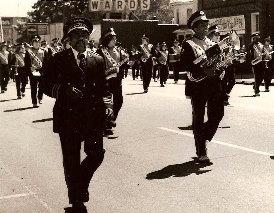 Band members march past Ward's during a parade