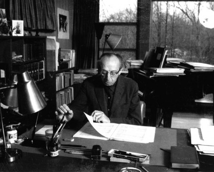 Aaron Copland studying music inside his studio