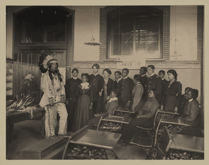 Native Americans in a class at Hampton University in the 1800s. This photo is courtesy of https://jubiloemancipationcentury.files.wordpress.com/2011/02/sioux-at-hampton-institute.png
