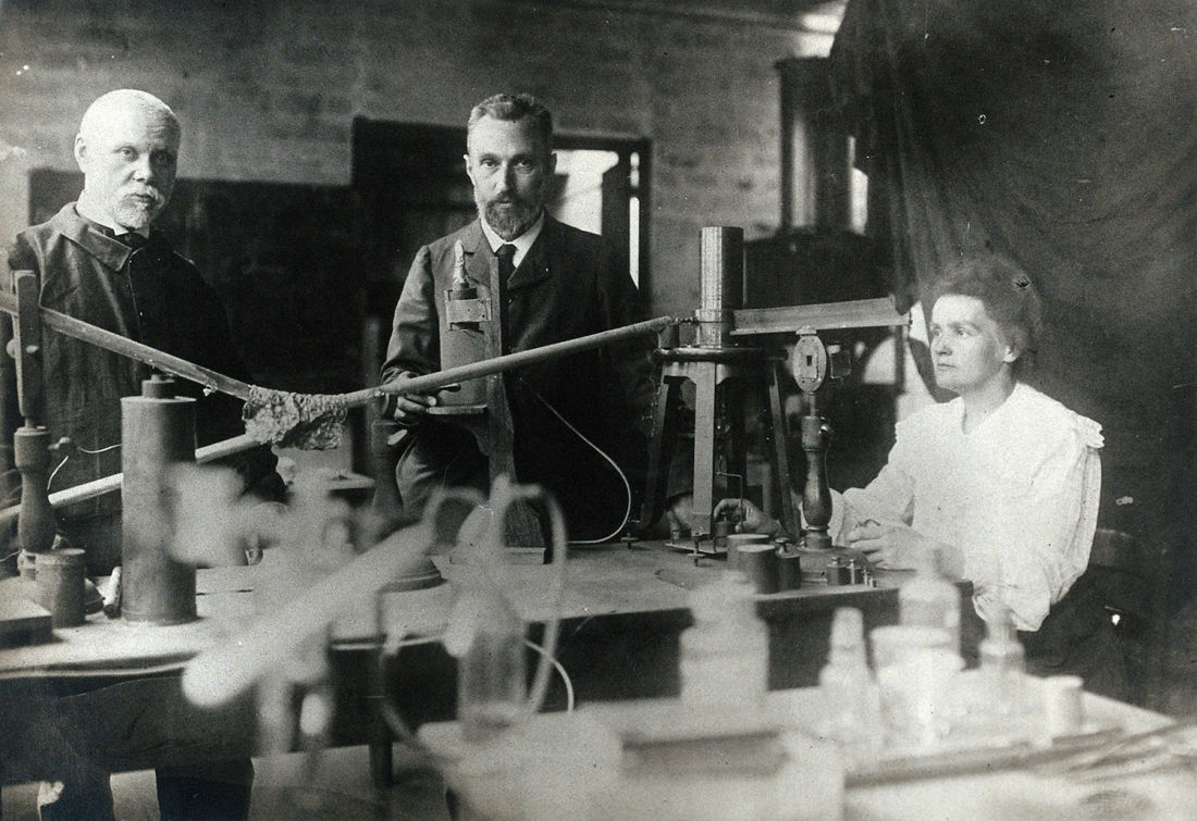 Marie and Pierre Curie (centre) with a man, using equipment in their laboratory, Paris, ca. 1900, Unknown photographer, Wellcome Collection  CC BY