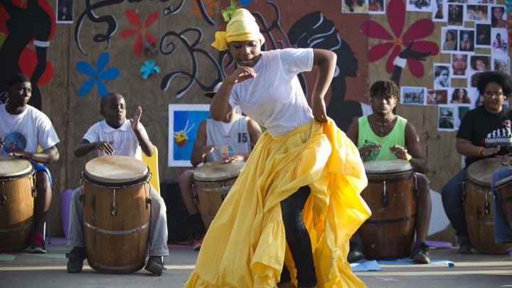 "The national dance of Puerto Rico, ""Bomba y Plena,"" is based on the interaction of the dancer and the drummers. A connection of sounds and movement is required for the dance."