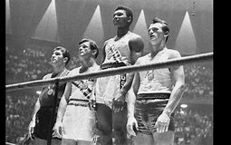Cassius Clay winning the gold medal in the 1960s Olympics. The young 18yr old was six years into fighting and had already won a title. He maintained an undefeated record 19-0, this was the start of his career. He ended up signing with a sponsership and it turned him into a professional boxer. Muhammad, Cassius at the time, was against all odds and was an example for many young African Americans. Though he expereinced hard times and judgement at such a young age, it was only preparing him for the journey to come.