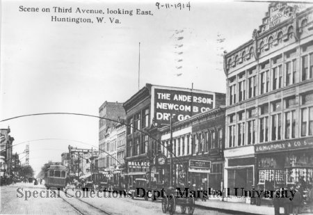 Looking east on Third Avenue, one can see the clock from Seth Thomas Clock Company, which stood outside of C.F. Reuschlein Jewelers