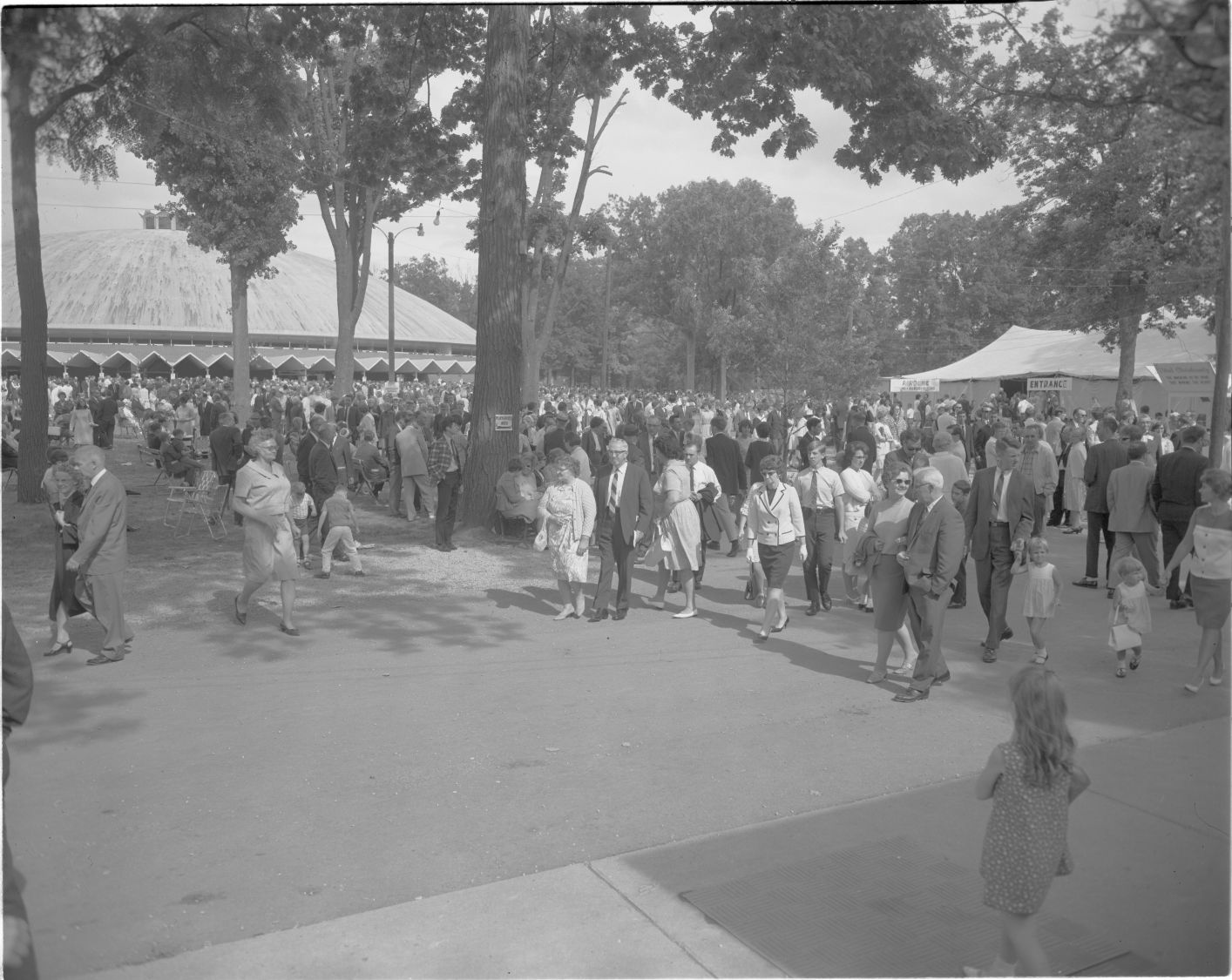 A photo of a Camp Meeting Service with Warner Auditorium in the background