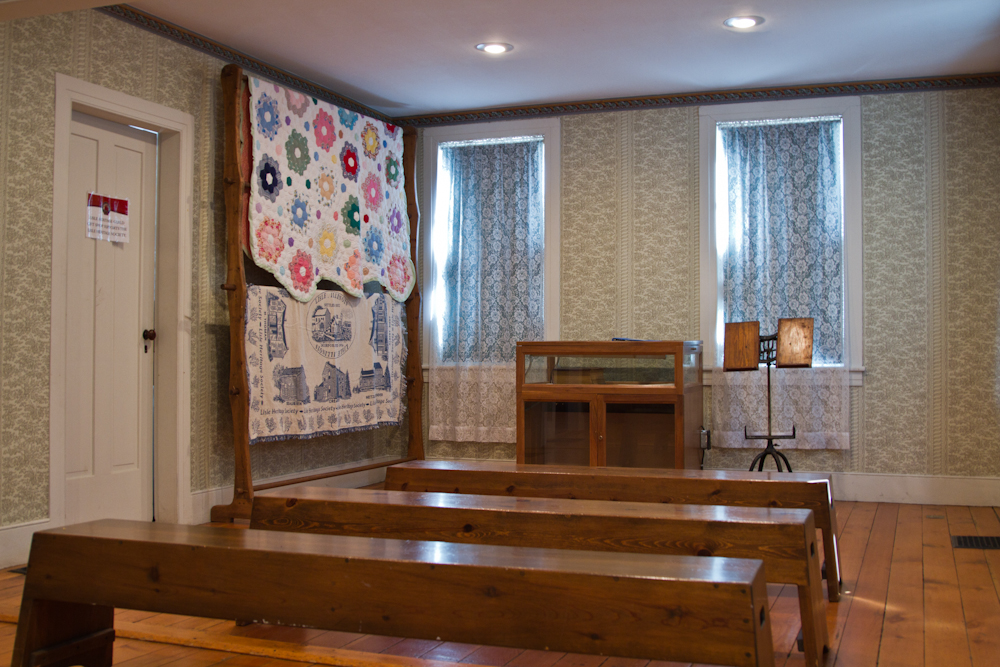 Double Parlor. The house's wallpaper patterns were recreated in the 1990s based on original pieces found during museum restoration.
