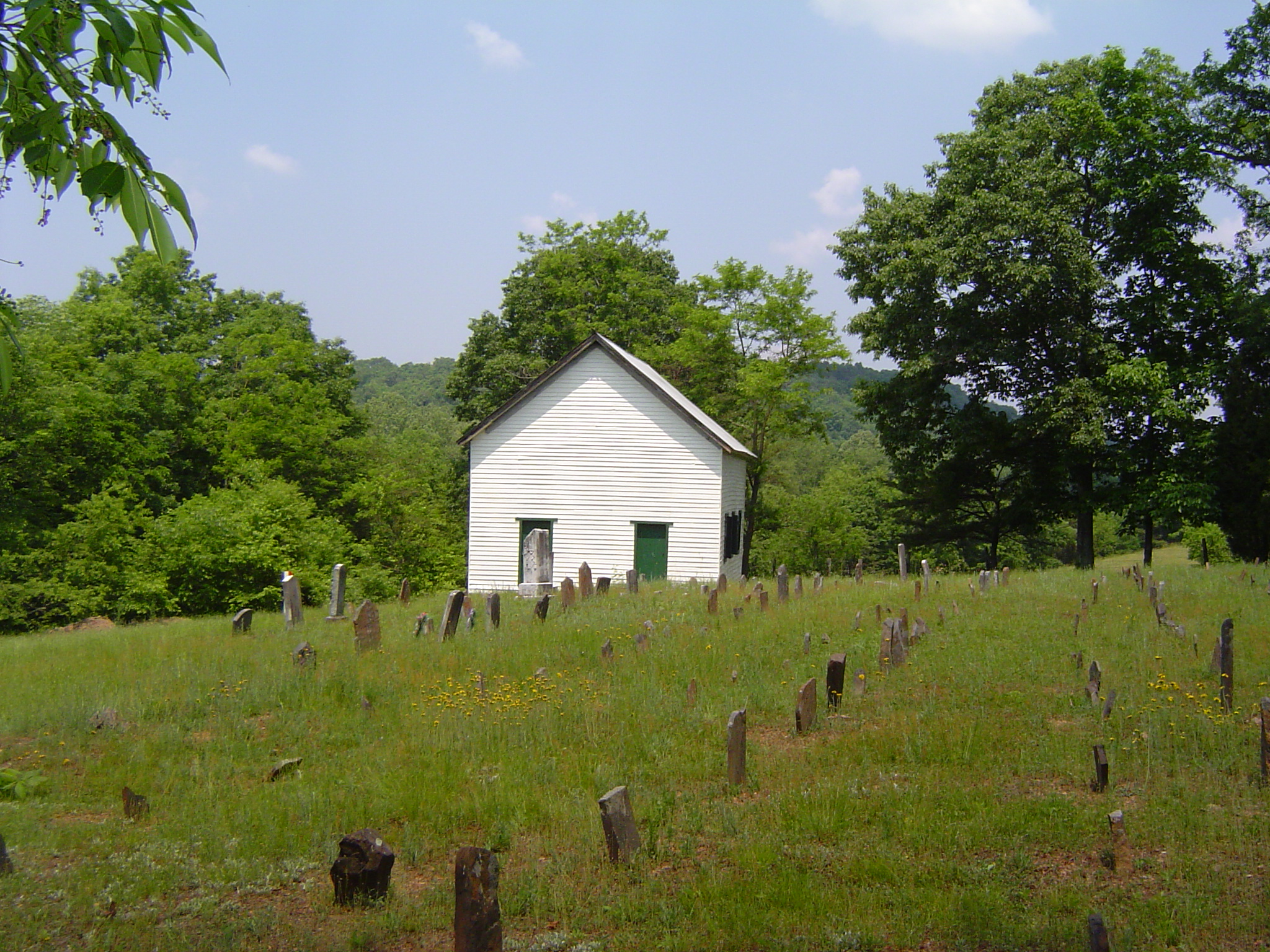 A view of the cemetery and two-door facade on the chapel